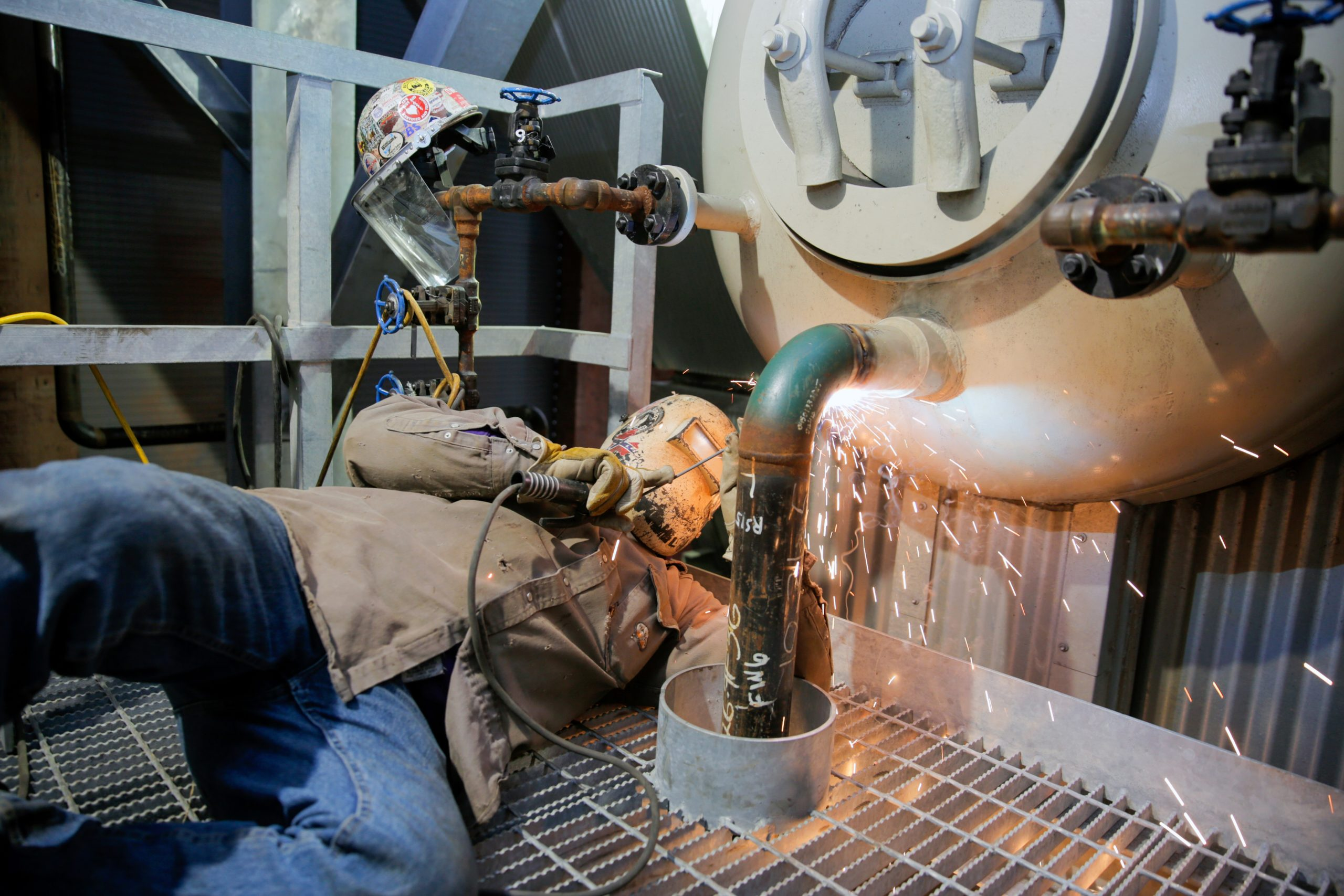 Pipe fitters weld the economizer, Predictive Emissions Monitoring System software, instrumentation on the boiler, steam and feed water piping, as well as the safeties before commissioning and preforming pre-start up.